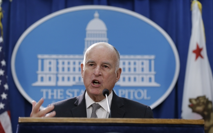 Gov. Jerry Brown discusses a lawsuit filed by 17 states and the District of Columbia over the Trump administration's plans to scrap vehicle emission standards during a news conference Tuesday, May 1, 2018, in Sacramento, Calif. The U.S. Environmental Protection Agency has moved to roll back tailpipe emissions standards for vehicles manufactured between 2022 and 2025. (AP Photo/Rich Pedroncelli)