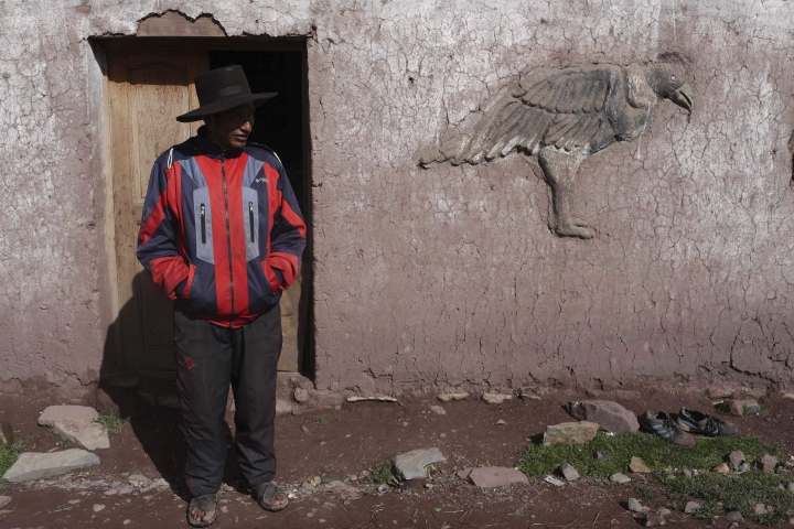 In this March 2, 2018 photo, Miguel Rocco stands in front of his home in Pitumarca, Peru. The local indigenous community has struggled with high rates of alcoholism, malnutrition and falling prices of wool from their prized alpaca. (AP Photo/Martin Mejia)