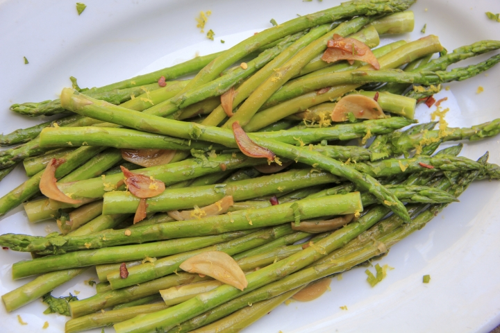 This April 30, 2018 photo shows quick-sauteed asparagus with a soy sauce glaze in Bethesda, Md. This dish is from a recipe by Melissa d'Arabian. (Melissa d'Arabian via AP)
