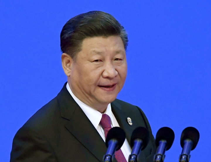 In this April 10, 2018, file photo, China's President Xi Jinping prepares to deliver his opening speech at the Boao Forum for Asia Annual Conference in Boao in south China's Hainan province. Chinese and American officials will be trying to defuse tensions pushing the world's two largest economies toward trade war in meetings in Beijing beginning Thursday, May 3, 2018. Analysts say that chances for a breakthrough seem slim given the two sides' desperate rivalry in strategic technologies such as semiconductors that underlies the dispute.(Naohiko Hatta/Kyodo News via AP, File)