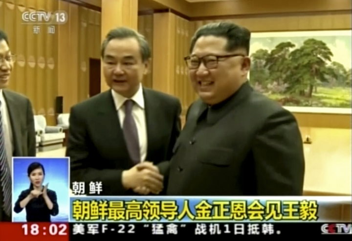 In this image taken from video footage by China's CCTV via AP Video, Chinese Foreign Minister Wang Yi, left, meets North Korean leader Kim Jong Un in Pyongyang, North Korea, Thursday, May 3, 2018. China's foreign minister congratulated North Korean leader Kim Jong Un on Thursday on his moves to reduce tensions with South Korea, China said. Their meeting in Pyongyang underscored warming ties and Beijing's desire to remain a key player in the Korean Peninsula peace process. (CCTV via AP Video)