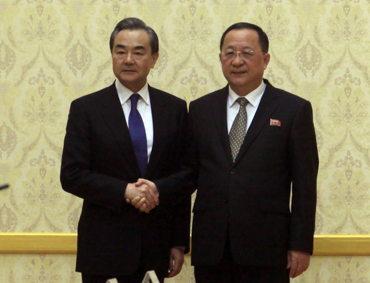North Korean Foreign Minister Ri Yong Ho, right, poses with Chinese Foreign Minister Wang Yi at the Mansudae Assembly Hall in Pyongyang, North Korea Wednesday, May 2, 2018. (AP Photo/Jon Chol Jin)