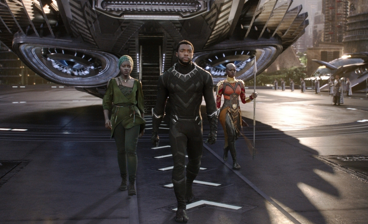 "This image released by Disney shows Lupita Nyong'o, left, and Chadwick Boseman and Danai Gurira in a scene from Marvel Studios' ""Black Panther."" The global smash hit garnered seven nominations for the MTV Movie & TV Awards, including one for Boseman. The awards will be held on June 18. (Matt Kennedy/Marvel Studios-Disney via AP)"