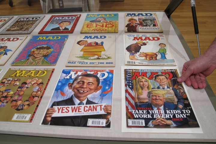 "A new exhibit celebrating the artistic legacy of MAD magazine that includes several examples of magazines over the years is displayed on Thursday, May 3, 2018, in Columbus, Ohio. ""Artistically Mad: Seven Decades of Satire"" opens at the Billy Ireland Cartoon Library & Museum at Ohio State University on Saturday, May 5, and runs through Oct. 21. The exhibit will include original drawings and paintings, displays of vintage MAD magazines and memorabilia such as trading cards and board games. (AP Photo/Andrew Welsh-Huggins)"