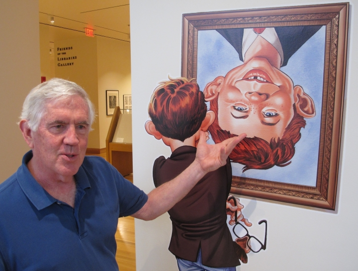 """Cartoonist and curator Brian Walker talks about the artistic history of MAD magazine ahead of the opening of a new exhibit on MAD artists and illustrators, on Thursday, May 3, 2018, in Columbus, Ohio. """"Artistically Mad: Seven Decades of Satire"""" opens at the Billy Ireland Cartoon Library & Museum at Ohio State University on Saturday and runs through Oct. 21. The exhibit will include original drawings and paintings, displays of vintage MAD magazines and memorabilia such as trading cards and board games. (AP Photo/Andrew Welsh-Huggins)"""
