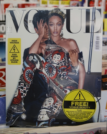 May Vogue Italia cover hits a newsstand in Milan, Italy, Friday, May 4, 2018. Gigi Hadid and Vogue Italia have separately apologized for the May Vogue Italia cover showing the top model with a darker skin tone and hair color that set off a social media backlash and underlined the lack of diversity in the fashion industry. The cover shot by Steven Klein shows the normally blonde Hadid with dark hair and heavily bronzed skin, wearing matching a Dolce & Gabbana sequined legging ensemble with matching tiara. Inside, Hadid poses in beachwear in the spread titled ''High Voltage.'' (AP Photo/Luca Bruno)