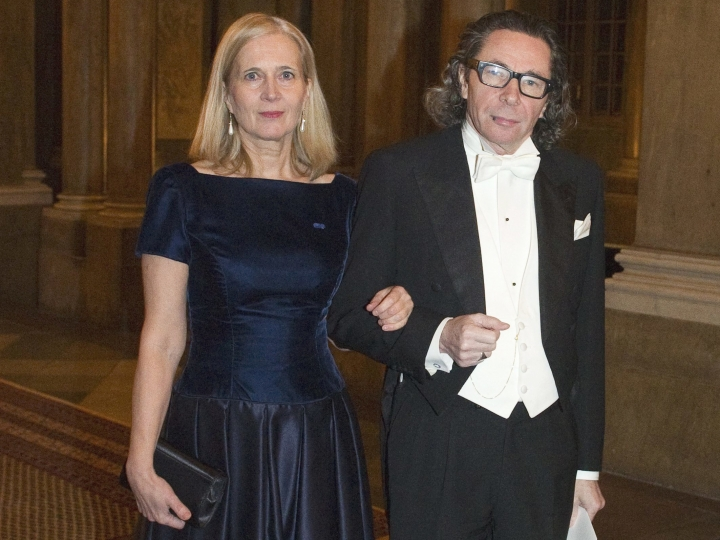 FILE - In this Dec. 11, 2011 file photo, Swedish Academy member Katarina Frostenson, left and photographer Jean Claude Arnault attend the Kings Nobel dinner at the Royal Palace in Stockholm. The Nobel Prize in literature will be not awarded this year following sex-abuse allegations and other issues within the ranks of the Swedish Academy that selects the winner, it was announced on Friday, May 4, 2018. The Swedish Academy's internal feud was triggered by an abuse scandal linked to Jean-Claude Arnault, a major cultural figure in Sweden who is also the husband of poet Katarina Frostenson, an academy member. (Henrik Montgomery/TT News Agency via AP, File)