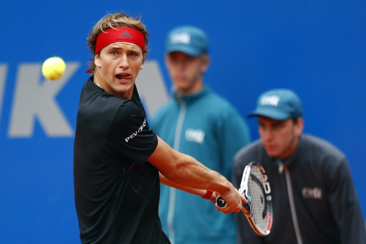 Alexander Zverev of Germany watches the ball as he returns the ball to Germany's Jan-Lennard Struff during the quarter final match at the ATP tennis tournament in Munich, Germany, Friday, May 4, 2018. (AP Photo/Matthias Schrader)
