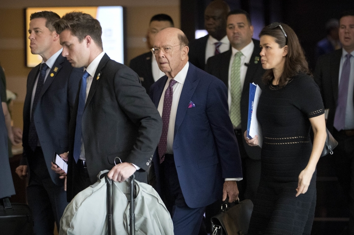 U.S. Commerce Secretary Wilbur Ross, center, leaves his hotel in Beijing, Friday, May 4, 2018. Chinese and U.S. officials met face-to-face Thursday to try and resolve a dispute over technology that has taken the world's two largest economies the closest they've ever come to a trade war. (AP Photo/Mark Schiefelbein)