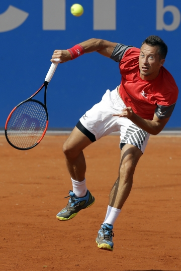 Philipp Kohlschreiber of Germany returns the ball to Germany's Maximilian Marterer during the semifinal match at the ATP tennis tournament in Munich, Germany, Saturday, May 5, 2018. (AP Photo/Matthias Schrader)