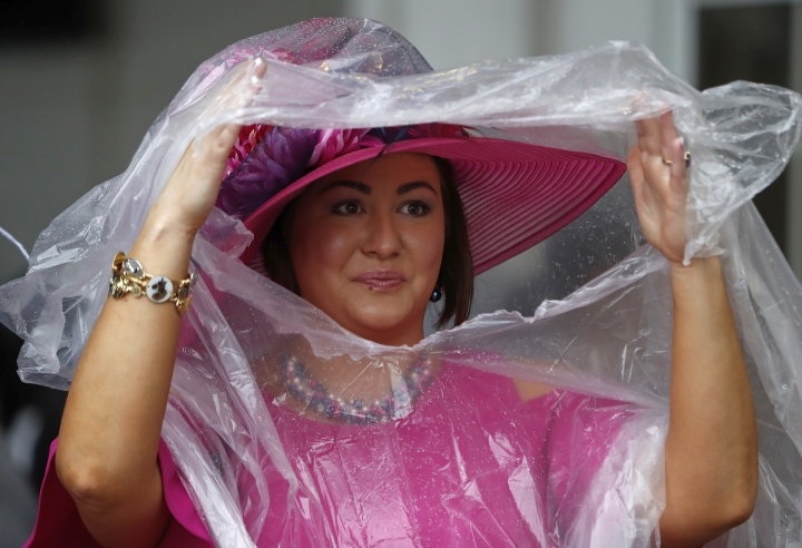 A woman wears a hat before the 144th running of the Kentucky Derby horse race at Churchill Downs Saturday, May 5, 2018, in Louisville, Ky. (AP Photo/John Minchillo)