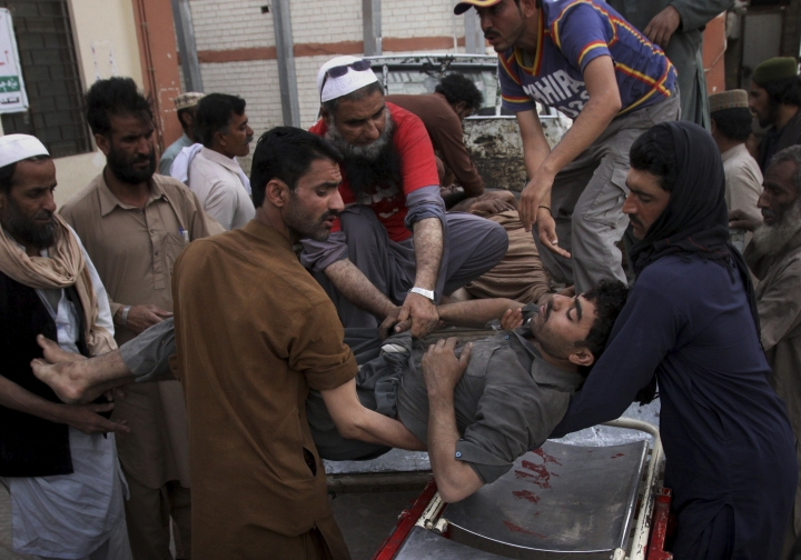 Pakistani volunteers and mine workers shift to their injured colleague on a stretcher upon arrival at a hospital in Quetta, Pakistan, Saturday, May 5, 2018. A government official says a methane gas explosion in a coal mine has killed some miners and injured few in southwest Pakistan. (AP Photo/Arshad Butt)