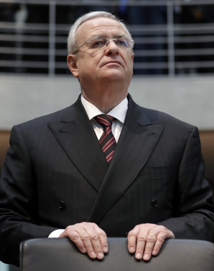 FILE - In this Jan. 19, 2017 file photo Martin Winterkorn, former CEO of the German car manufacturer 'Volkswagen', arrives for a questioning at an investigation committee of the German federal parliament in Berlin. VW spokesman Michael Brendel says the German automaker's supervisory board is checking whether it can demand damage claims from former VW CEO Martin Winterkorn in connection with the company's diesel emissions cheating scandal. German newspaper Frankfurter Allgemeine Sonntagszeitung reported Sunday May 6, 2018 that Winterkorn could stand to lose his entire property in connection with the company's investigation. (AP Photo/Michael Sohn, file)