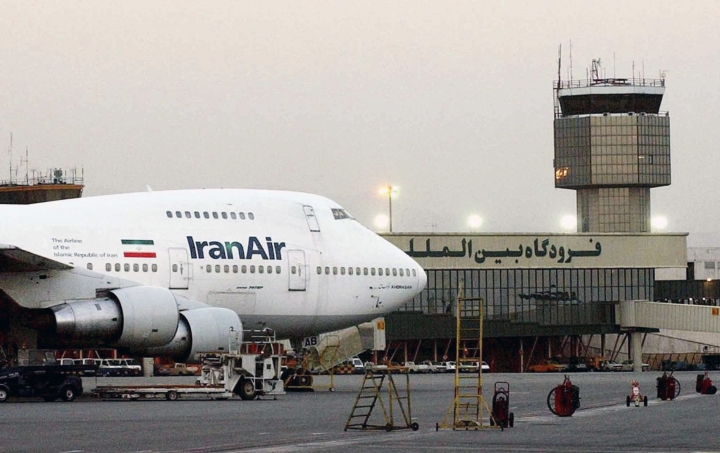 FILE - In this June 2003 file photo, a Boeing 747 of the state carrier IranAir is seen at Mehrabad International Airport in Tehran. From brand-new airplanes to oilfields, billions of dollars of deals stand on the line for international corporations as President Donald Trump weighs whether to pull America out of Iran's nuclear deal with world powers. (AP Photo/Hasan Sarbakhshian, File)