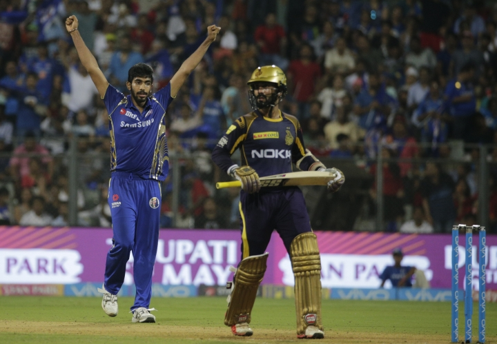 Mumbai Indian's Jasprit Bumrah, left, celebrates the dismissal of Kolkata Knight Riders' Andre Russell with his team player Hardik Pandya during the VIVO IPL cricket T20 match in Mumbai, India, Sunday, May 6, 2018. (AP Photo/Rafiq Maqbool)