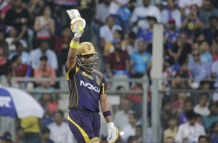 Kolkata Knight Riders' Robin Uthappa celebrates after scoring 50 runs during the VIVO IPL cricket T20 match against Mumbai Indian's in Mumbai, India, Sunday, May 6, 2018. (AP Photo/Rafiq Maqbool)