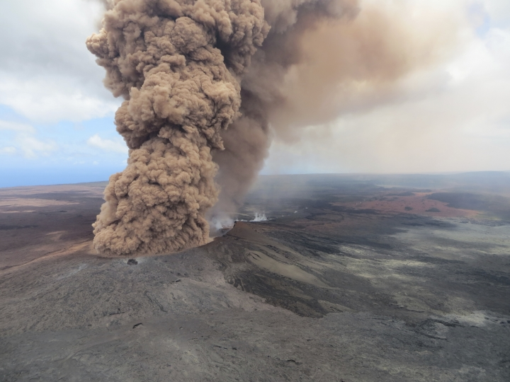 This Friday, May 4, 2018, aerial image released by the U.S. Geological Survey, at 12:46 p.m. HST, a column of robust, reddish-brown ash plume occurred after a magnitude 6.9 South Flank of Kīlauea earthquake shook the Big Island of Hawaii, Hawaii. The Kilauea volcano sent more lava into Hawaii communities Friday, a day after forcing more than 1,500 people to flee from their mountainside homes, and authorities detected high levels of sulfur gas that could threaten the elderly and people with breathing problems. (U.S. Geological Survey via AP)