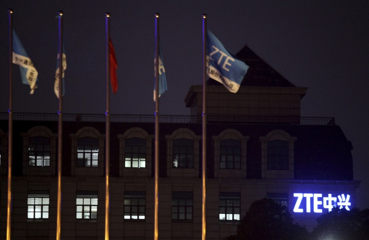 FILE - In this March 16, 2016, file photo, flags fly over the ZTE Global Cloud Computing Center in Nanjing in eastern China's Jiangsu province. Chinese tech company ZTE said late Sunday, May 6, 2018 it applied to the U.S. Commerce Department to suspend a seven-year ban on doing business with U.S. technology exporters. (Chinatopix via AP, File)
