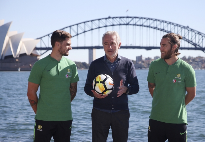Australia's national soccer team head coach Bert van Marwijk, center, poses for a photo with players Joshua Brillante, right, and Josh Risdon in Sydney, Monday, May 7, 2018. Van Marwijk has named 32 players as part of his preliminary squad for the 2018 World Cup in Russia. (AP Photo/Rick Rycroft)
