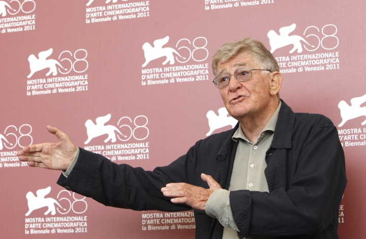 FILE - In this Tuesday, Sept. 6, 2011 file photo director Ermanno Olmi poses for the photo call of the movie 'Il Villaggio di Cartone' at the 68th edition of the Venice Film Festival in Venice, Italy. Prize-winning Italian film director Ermanno Olmi has died Monday May 7, 2018 at the age of 86. (AP Photo/Andrew Medichini, File )