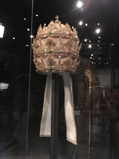 """In a May 5, 2018 photo, a jewel-encrusted papal tiara from the Sistine Chapel sacristy at the Vatican, is displayed at the Metropolitan Museum of Art in its """"Heavenly Bodies: Fashion and the Catholic Imagination,"""" the spring fashion exhibit at the museum's Costume Institute. (AP Photo/Jocelyn Noveck)"""