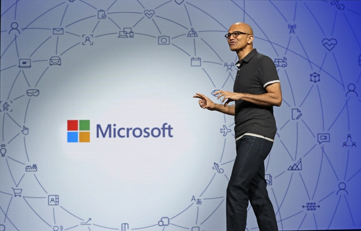 Microsoft CEO Satya Nadella delivers the keynote address at Build, the company's annual conference for software developers Monday, May 7, 2018, in Seattle. (AP Photo/Elaine Thompson)