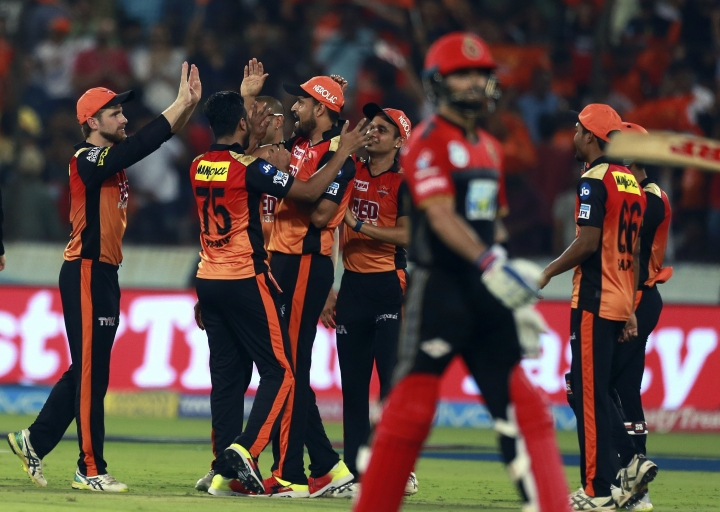 Sunrisers Hyderabad bowler Shakib Al Hasan , 2nd form left, celebrates the wicket of Virat Kohli with Yusuf Pathan during VIVO IPL cricket T20 match against Royal Challengers Bangalore in Hyderabad, India, Monday, May 7, 2018. (AP Photo/Mahesh Kumar A.)