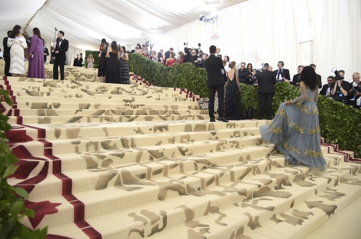 Media appear on the carpet before The Metropolitan Museum of Art's Costume Institute benefit gala celebrating the opening of the Heavenly Bodies: Fashion and the Catholic Imagination exhibition on Monday, May 7, 2018, in New York. (Photo by Evan Agostini/Invision/AP)