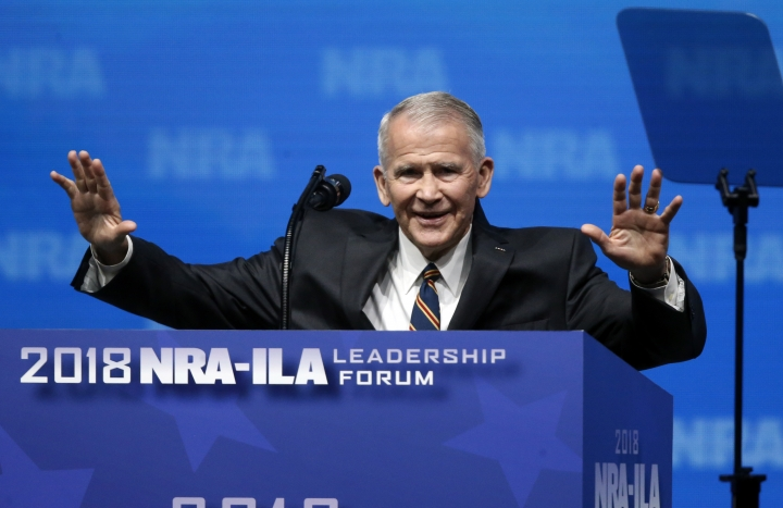 In this May 4, 2018 photo, former U.S. Marine Lt. Col. Oliver North acknowledges attendees as he gives the Invocation at the National Rifle Association-Institute for Legislative Action Leadership Forum in Dallas. The NRA announced today that North will become President of the National Rifle Association of America within a few weeks, a process the NRA Board of Directors initiated this morning. (AP Photo/Sue Ogrocki)