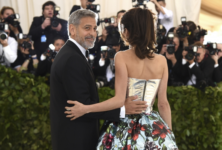 George Clooney, left, and Amal Clooney attend The Metropolitan Museum of Art's Costume Institute benefit gala celebrating the opening of the Heavenly Bodies: Fashion and the Catholic Imagination exhibition on Monday, May 7, 2018, in New York. (Photo by Evan Agostini/Invision/AP)