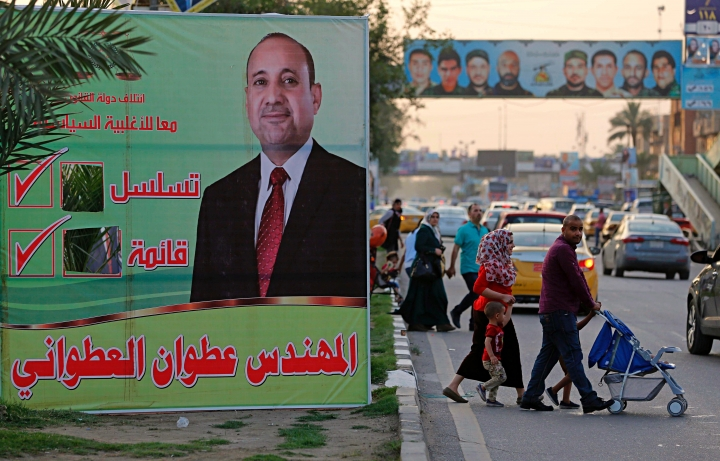 In this Thursday, May 3, 2018 photo, campaign posters for parliamentary elections adorn a street in Baghdad, Iraq. Voters head to the polls next weekend for the first time since the government declared victory against the Islamic State group, in elections that could tilt the balance of power between the United States and Iran. The atrocities committed by IS against fellow Sunnis, and the national campaign against the extremist group, seem to have eased the sectarian tensions that marked past votes. (AP Photo/Karim Kadim)