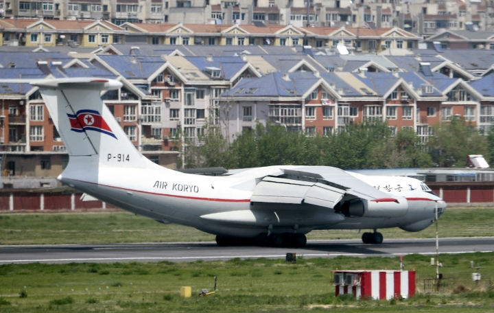 CORRECTS SECOND SENTENCE - A North Korea's Air Koryo plane lands in an airport in Dalian, China, Tuesday, May 8, 2018. The plane arrived as Japanese and South Korean media speculated that a high-ranking North Korean official was visiting the Chinese port city. (Minoru Iwasaki/Kyodo News via AP)