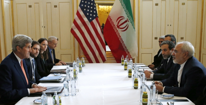 FILE - In this Jan. 16, 2016 file-pool photo, U.S. Secretary of State John Kerry, left, meets with Iranian Foreign Minister Mohammad Javad Zarif, right, in Vienna, Austria. Iran's nuclear deal with world powers faces its biggest diplomatic challenge yet as President Donald Trump appears poised to withdraw the U.S. from the accord. (Kevin Lamarque/Pool Photo via AP, File)