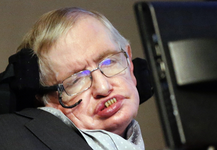 FILE - In this Dec. 16, 2015 file photo, professor Stephen Hawking listens to a news conference in London. The family of the late British physicist Stephen Hawking has opened a lottery for 1,000 tickets for a service of thanksgiving in his honor at Westminster Abbey. (AP Photo/Frank Augstein, File)