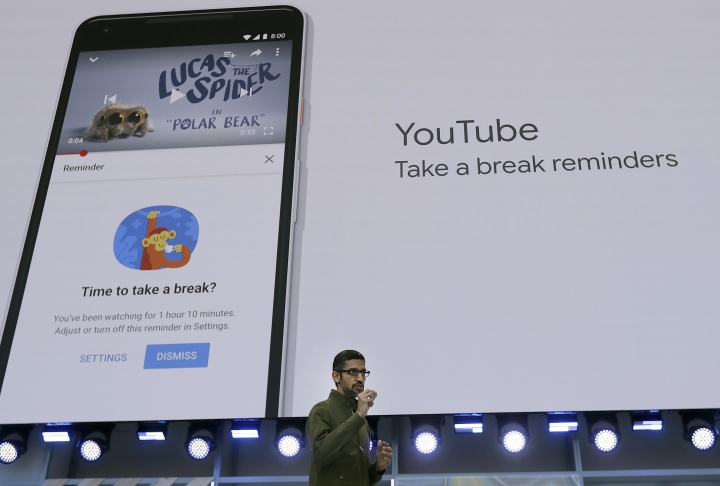 Google CEO Sundar Pichai speaks about YouTube break reminders at the Google I/O conference in Mountain View, Calif., Tuesday, May 8, 2018. (AP Photo/Jeff Chiu)