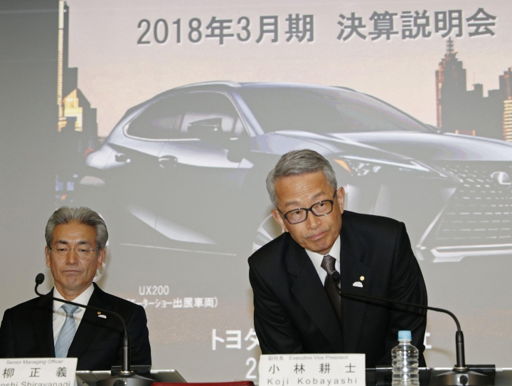 Koji Kobayashi, right, executive vice president of Toyota Motor Corp., and Senior Managing Officer Masayoshi Shirayanagi, attend a press conference on the automaker's quarterly result in Tokyo Wednesday, May 9, 2018. Toyota Motor Corp. is reporting its quarterly profit rose 21 percent as cost cuts and booming sales in some markets offset the damage from higher U.S. incentives. Toyota, which makes the Camry sedan, Prius hybrid and Lexus luxury models, reported Wednesday January-March profit of 480.8 billion yen ($4.4 billion), up from 398 billion yen the same quarter the previous year. (Kyodo News via AP)