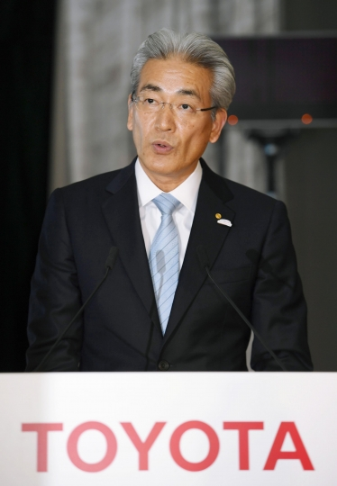 Masayoshi Shirayanagi, senior managing officer of Toyota Motor Corp., speaks during a press conference on the automaker's quarterly result in Tokyo Wednesday, May 9, 2018. Toyota Motor Corp. is reporting its quarterly profit rose 21 percent as cost cuts and booming sales in some markets offset the damage from higher U.S. incentives. Toyota, which makes the Camry sedan, Prius hybrid and Lexus luxury models, reported Wednesday January-March profit of 480.8 billion yen ($4.4 billion), up from 398 billion yen the same quarter the previous year. (Kyodo News via AP)