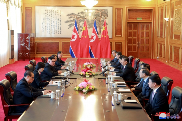 """In this May 7, 2018, photo provided by the North Korean government, North Korean leader Kim Jong Un, third from left, holds a talk with Chinese President Xi Jinping, fourth from right, in Dalian, China. Independent journalists were not given access to cover the event depicted in this image distributed by the North Korean government. The content of this image is as provided and cannot be independently verified. Korean language watermark on image as provided by source reads: """"KCNA"""" which is the abbreviation for Korean Central News Agency. (Korean Central News Agency/Korea News Service via AP)"""