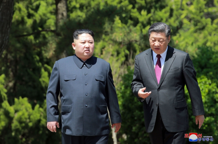 "In this Tuesday, May 8, 2018, photo provided by the North Korean government, North Korean leader Kim Jong Un, left, and Chinese President Xi Jinping talk while walking in Dalian, China. Independent journalists were not given access to cover the event depicted in this image distributed by the North Korean government. The content of this image is as provided and cannot be independently verified. Korean language watermark on image as provided by source reads: ""KCNA"" which is the abbreviation for Korean Central News Agency. (Korean Central News Agency/Korea News Service via AP)"