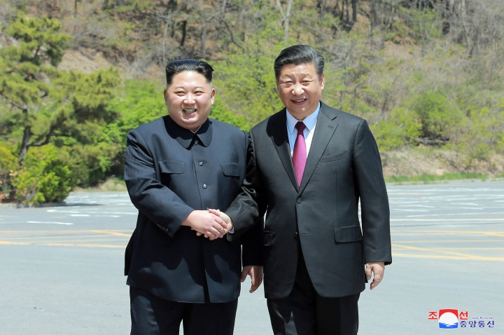 """In this Tuesday, May 8, 2018, photo provided by the North Korean government, North Korean leader Kim Jong Un, left, shakes hands with Chinese President Xi Jinping in Dalian, China. Independent journalists were not given access to cover the event depicted in this image distributed by the North Korean government. The content of this image is as provided and cannot be independently verified. Korean language watermark on image as provided by source reads: """"KCNA"""" which is the abbreviation for Korean Central News Agency. (Korean Central News Agency/Korea News Service via AP)"""