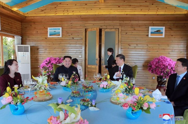 "In this Tuesday, May 8, 2018, photo provided by the North Korean government, North Korean leader Kim Jong Un, center left, Kim's younger sister, Kim Yo Jong, left, Chinese President Xi Jinping, center right, and Song Tao, head of the ruling Communist Party's International Department meet during lunch in Dalian, China. Independent journalists were not given access to cover the event depicted in this image distributed by the North Korean government. The content of this image is as provided and cannot be independently verified. Korean language watermark on image as provided by source reads: ""KCNA"" which is the abbreviation for Korean Central News Agency. (Korean Central News Agency/Korea News Service via AP)"