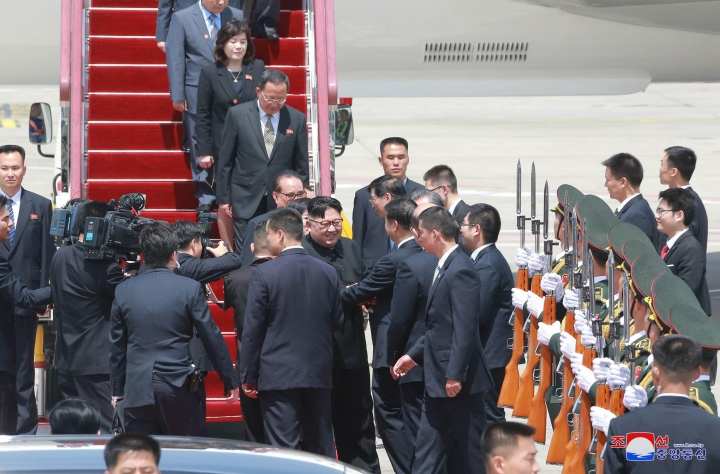 """In this Monday, May 7, 2018, photo provided by the North Korean government, North Korean leader Kim Jong Un, center, arrives at an airport in Dalian, China. Independent journalists were not given access to cover the event depicted in this image distributed by the North Korean government. The content of this image is as provided and cannot be independently verified. Korean language watermark on image as provided by source reads: """"KCNA"""" which is the abbreviation for Korean Central News Agency. (Korean Central News Agency/Korea News Service via AP)"""