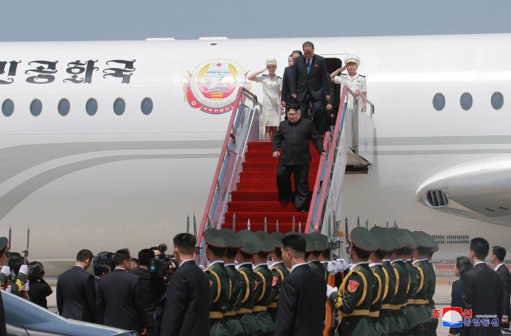 "In this Monday, May 7, 2018, photo provided by the North Korean government, North Korean leader Kim Jong Un, center, arrives at an airport in Dalian, China. Independent journalists were not given access to cover the event depicted in this image distributed by the North Korean government. The content of this image is as provided and cannot be independently verified. Korean language watermark on image as provided by source reads: ""KCNA"" which is the abbreviation for Korean Central News Agency. (Korean Central News Agency/Korea News Service via AP)"