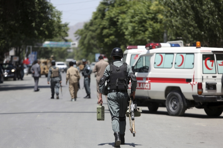 Afghan security personnel inspect at the site of a suicide attack, in the center of Kabul, Afghanistan, Wednesday, May 9, 2018. Three suicide bombers struck two police stations in Afghanistan's capital on Wednesday, wounding at least six people, officials said. (AP Photo/Rahmat Gul)