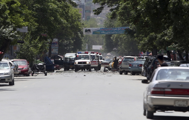 Ambulances arrive in the area of a suicide attack in the center of Kabul, Afghanistan, Wednesday, May 9, 2018. Three suicide bombers struck two police stations in Afghanistan's capital on Wednesday, wounding at least six people, officials said. (AP Photo/Rahmat Gul)
