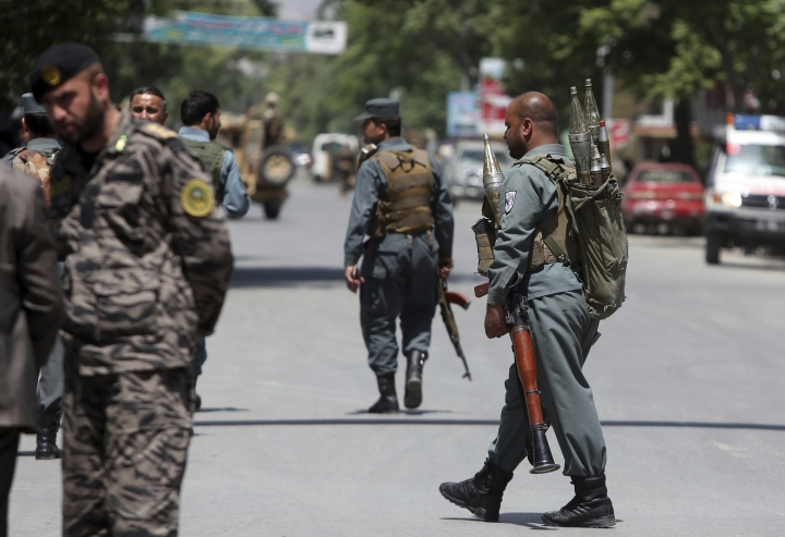 Afghan security personnel inspect at the site of suicide attack in the center of Kabul, Afghanistan, Wednesday, May 9, 2018. Three suicide bombers struck two police stations in Afghanistan's capital on Wednesday, wounding at least six people, officials said. (AP Photo/Rahmat Gul)