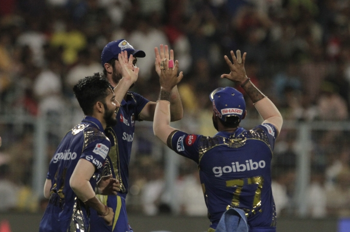 Mumbai Indians' players celebrate the dismissal of Kolkata Knight Riders' Nitish Rana during the VIVO IPL cricket T20 match in Kolkata, India, Wednesday, May 9, 2018. (AP Photo/Bikas Das)