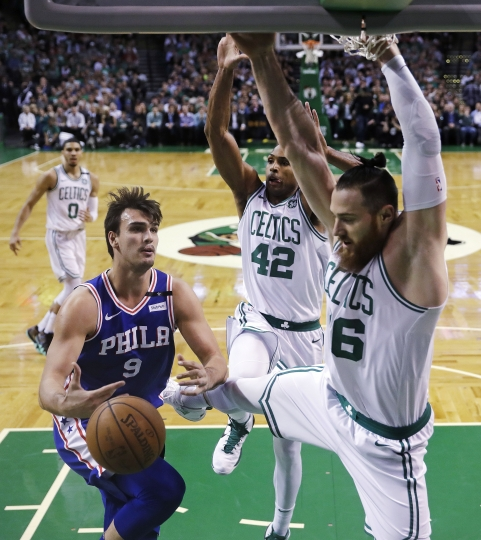 Boston Celtics center Aron Baynes, right, and forward Al Horford (42) block Philadelphia 76ers forward Dario Saric (9) during the first quarter of Game 5 of an NBA basketball playoff series in Boston, Wednesday, May 9, 2018. (AP Photo/Charles Krupa)
