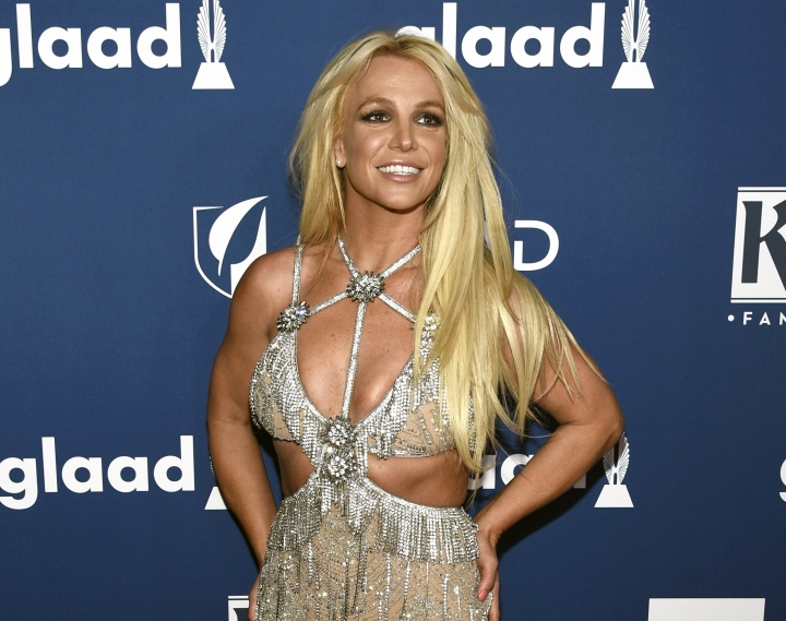 "FILE - In this April 12, 2018 file photo, Britney Spears arrives at the 29th annual GLAAD Media Awards in Beverly Hills, Calif. Spears is taking her act on the road this summer with her ""Piece of Me"" world tour, traveling across North America and Europe. The first show is July 12 in Washington. (Photo by Chris Pizzello/Invision/AP, File)"