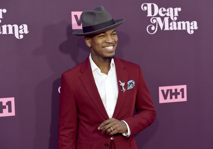 "FILE - In this May 3, 2018, file photo, Ne-Yo arrives at the 3rd annual ""Dear Mama: A Love Letter to Moms"" at The Theatre at Ace Hotel in Los Angeles. Kevin Foster, of Montclair, N.J., is accused of running a multimillion dollar scam that bilked singers Ne-Yo and Brian McKnight who invested in a sports drink company. (Photo by Chris Pizzello/Invision/AP, File)"